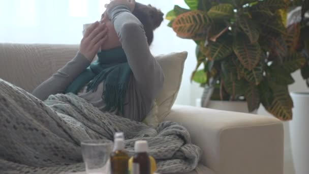 Sick woman lying on her sofa