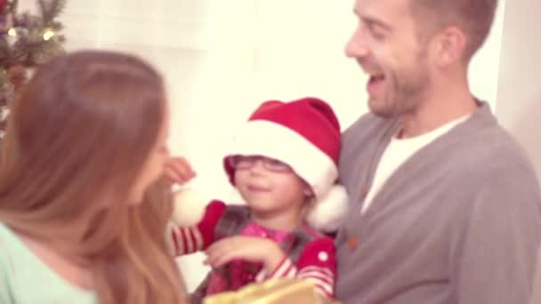 family near the Christmas tree