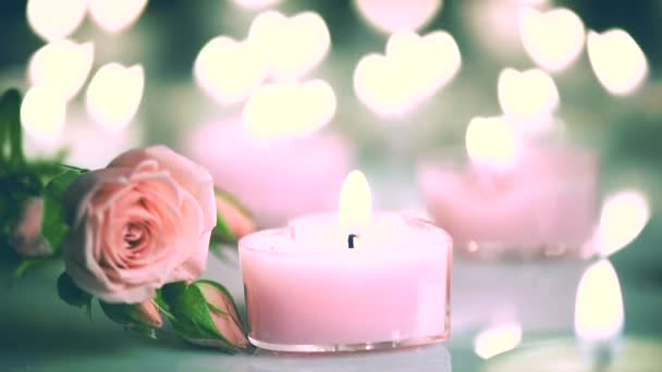 Pink burning candles and  roses
