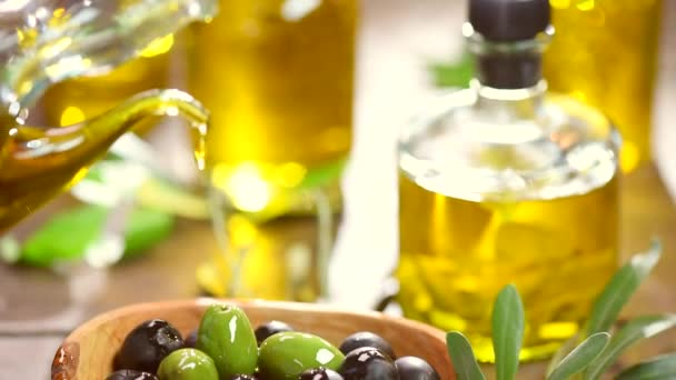 Olives and pouring olive oil.
