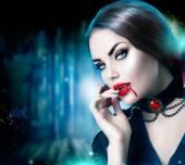 Fotografie schöne Halloween Vampir Frau