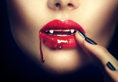 Sexy vampire woman lips with blood