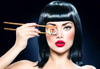 model girl eating sushi roll