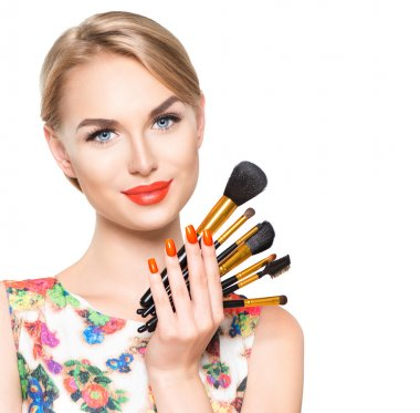 Beauty woman with makeup brushes.
