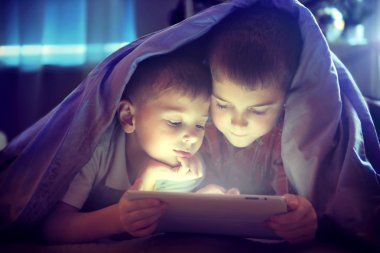 Two kids using tablet pc