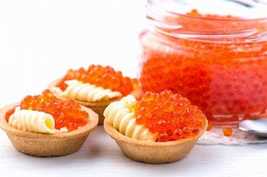 Tartlets with red caviar closeup.