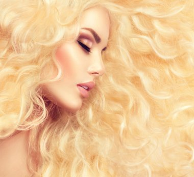 Fashion blond girl with  wavy hair