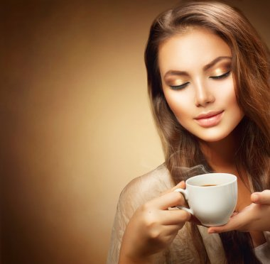 woman with cup of hot coffee