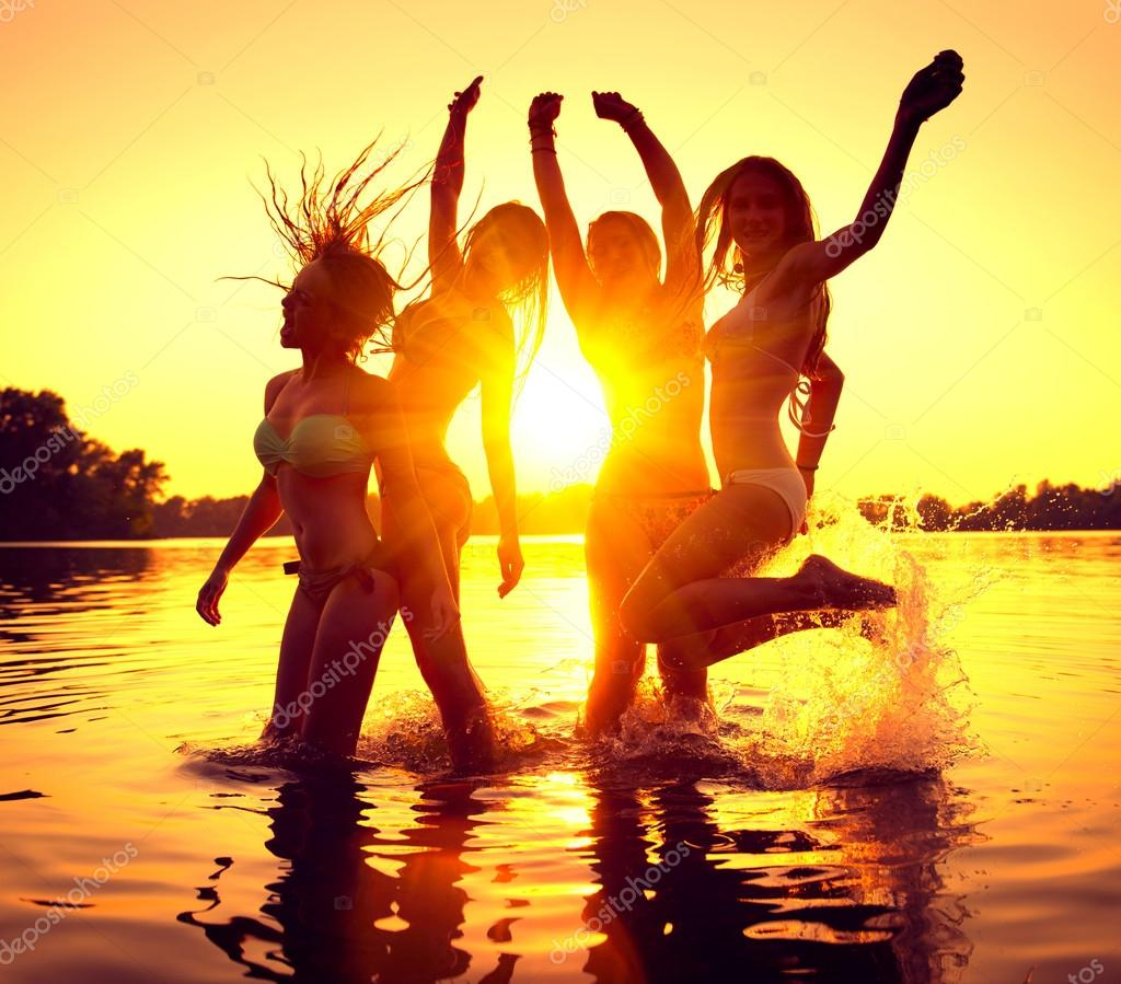 girls dancing in water on beautiful