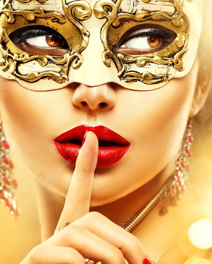 Woman wearing venetian  carnival mask