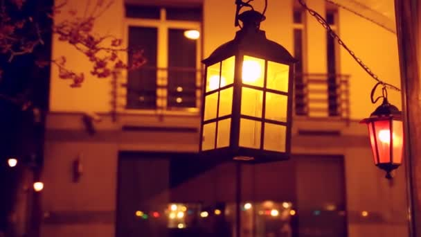 Swinging retro victorian style lamp at night urban style background.