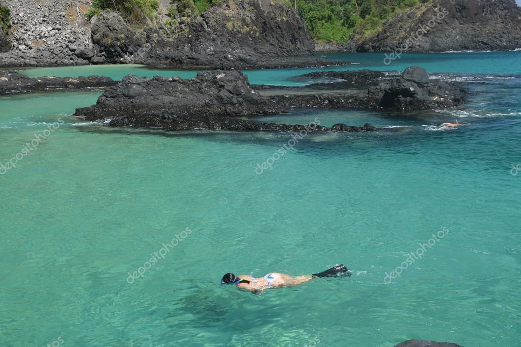 Diving in a crystalline sea beach in Fernando de Noronha,Brazil