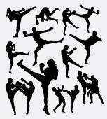 Photo Muay Thai kick boxing fighter silhouettes