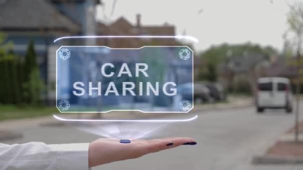 Női kéz mutatja hologram Car Sharing