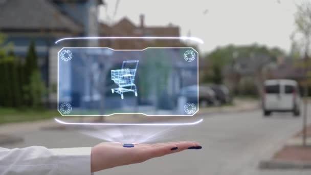 Female hand showing hologram shopping cart