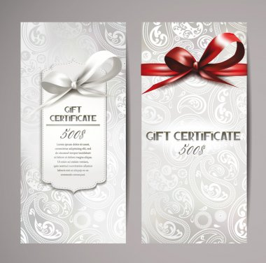 Elegant white gift certificates with silk ribbons and floral background