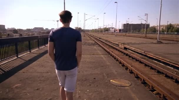 Handsome young man walking on train station