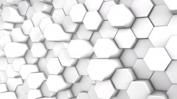 Weiße futuristische prismatische Sechsecke, Wabe, sechs, Bewegung auf minimalistischem Hintergrund. Das Konzept von Design und Technologie. 3D-Animation. Bewegen Sie die Kamera.