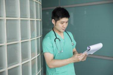 Chinese doctor wearing green scrubs