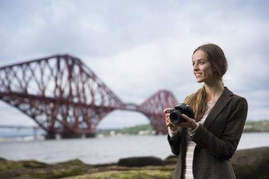 woman taking landscape photos