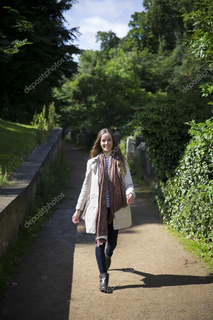 trendy woman walking in city