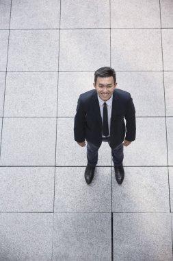 Asian businessman looking at the camera