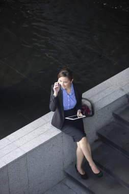 Asian Businesswoman using a smartphone.