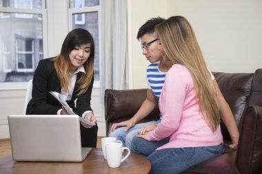 Asian couple meeting financial adviser
