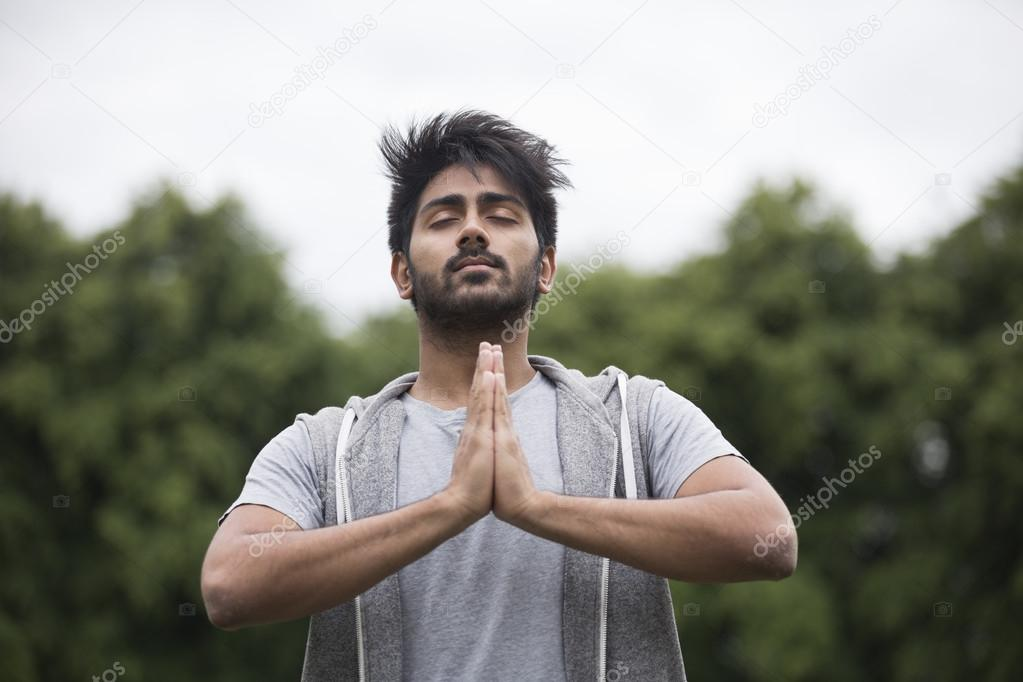 Indian Man Doing Yoga Exercise In Park Stock Photo