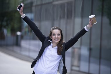 Businesswoman with arms up in the air