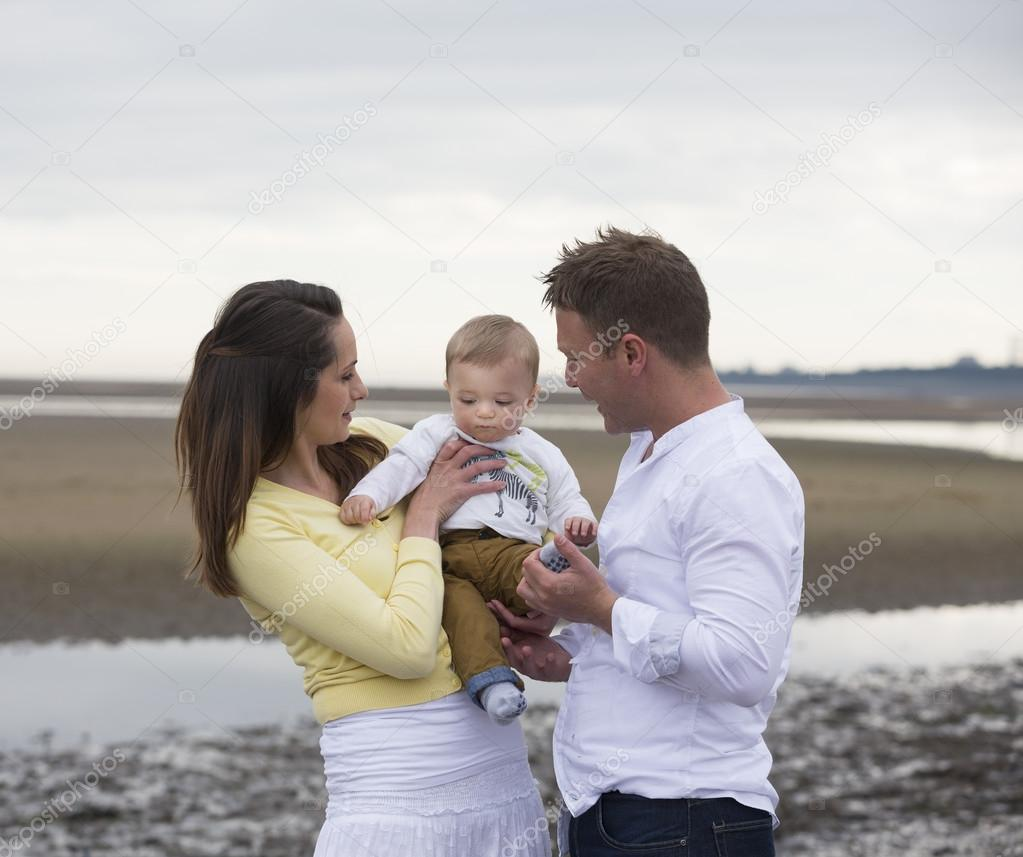 Young Family together on winter beach