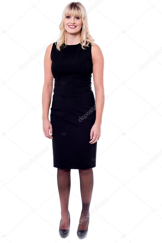 c4a225eee5c blonde woman in black sleeveless dress — Stock Photo © stockyimages ...
