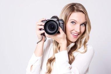 beautiful woman with photo camera