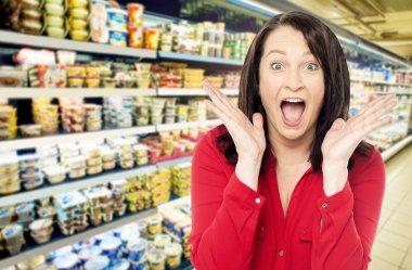 Amazed woman at supermarket