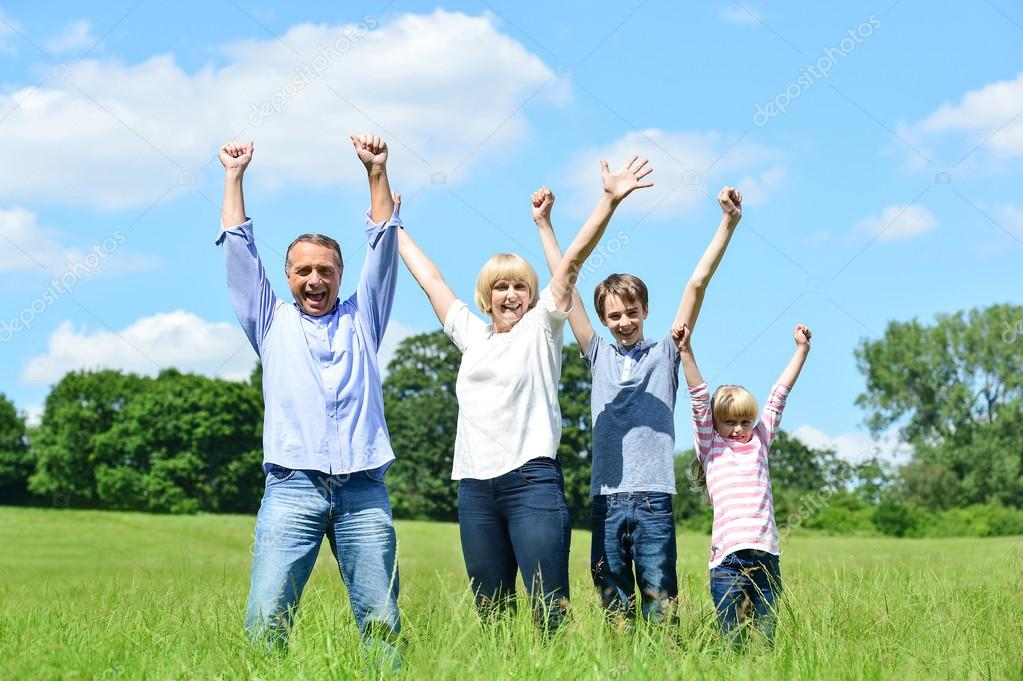 Family lifting arms up