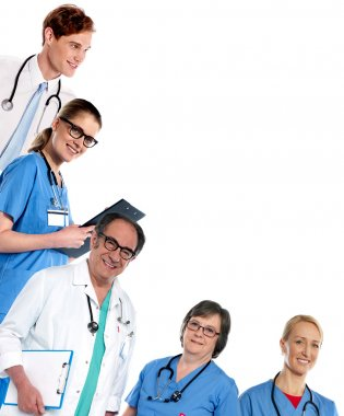 Doctors posing in L shape