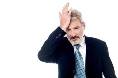 Businessman slapping his head