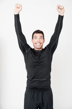 Athletic man with arms raised