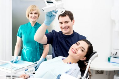Dentist and assistant with patient