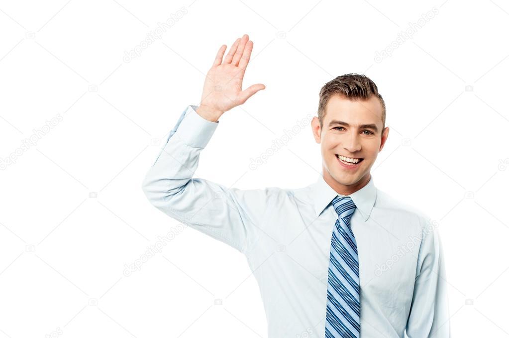 Handsome corporate man waving hand — Stock Photo ...