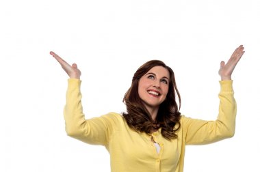 woman looking up and arms raised