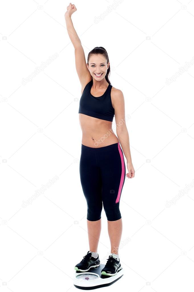 slim woman weighing herself ストック写真 stockyimages 76686363