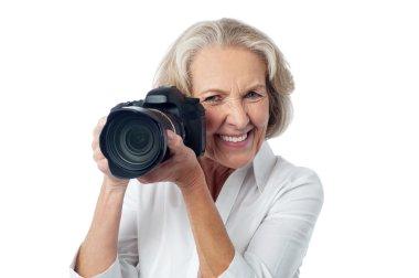 Senior woman taking photos