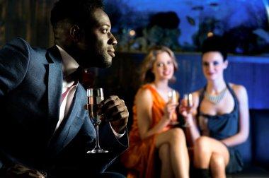 girls staring at attractive young man