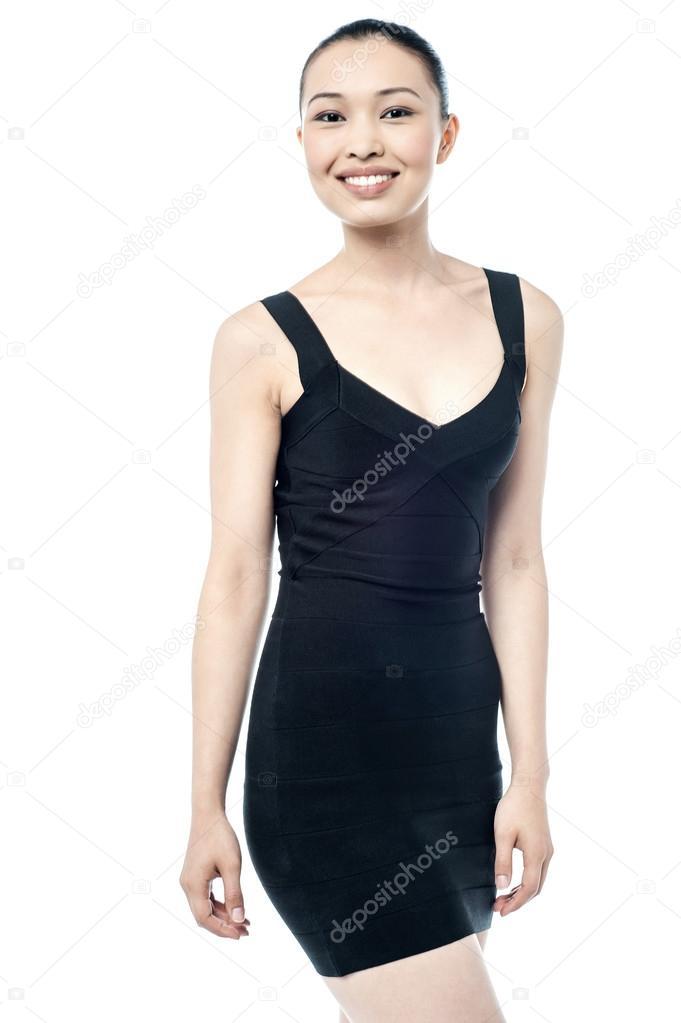a64ec7ec335 Pretty woman in black sleeveless dress — Stock Photo © stockyimages ...