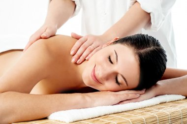 Therapist giving massage to woman