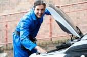 Photo mechanic repairing car