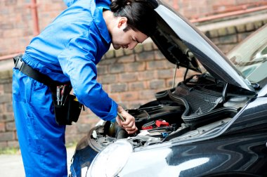 mechanic fixing car engine