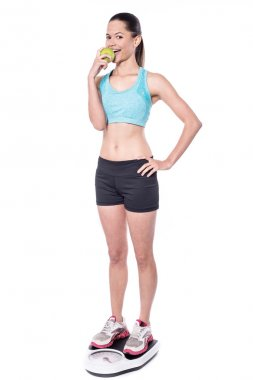 Young woman on weigh scale