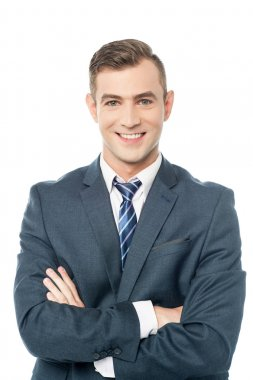 Business professional posing with arms folded